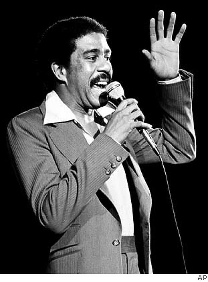 ** FILE ** Comedian-actor Richard Pryor is shown as he performs in 1977. Pryor, the caustic yet perceptive actor-comedian who lived dangerously close to the edge both on stage and off, has died, his ex-wife said Saturday, Dec. 10, 2005. He was 65. Pryor died of a heart attack at his home in the San Fernando Valley sometime late Friday or early Saturday, Flyn Pryor said. (AP Photo, File) Ran on: 12-11-2005  Richard Pryor talked bluntly and worked his own ordeals into his comedy. 1977 FILE PHOTO Photo: AP