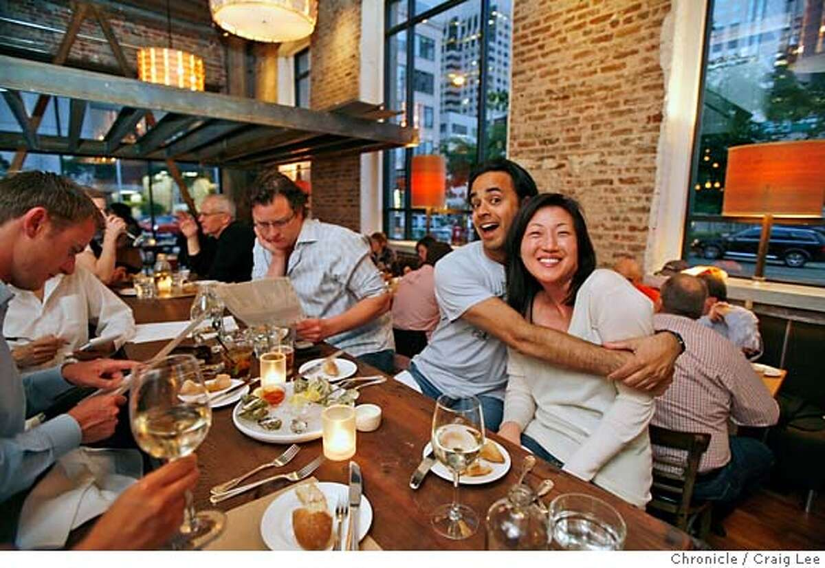 COMMUNAL06_277_cl.JPG Story on restaurants that have communal tables. This is Salt House restaurant at 545 Mission street in San Francisco. Photo of Imraan Aziz giving a hug to his new friend, Jun Chong at the communal table. They did not know each other until sitting next to each other at the communal table. The man in the glasses next to Imraan, is Robert Garrett. Event on 5/21/07 in San Francisco. photo by Craig Lee / The Chronicle MANDATORY CREDIT FOR PHOTOG AND SF CHRONICLE/NO SALES-MAGS OUT