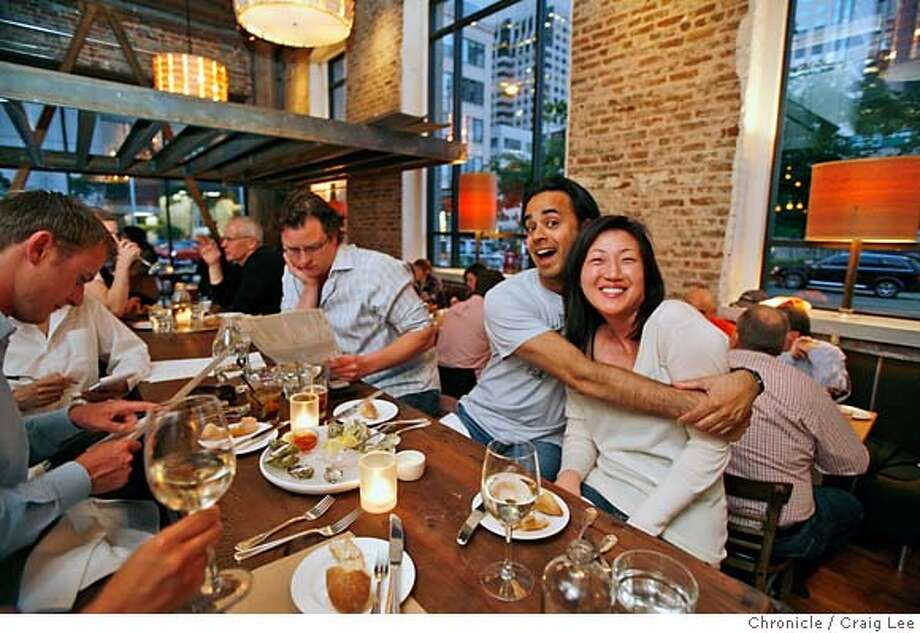COMMUNAL06_277_cl.JPG  Story on restaurants that have communal tables. This is Salt House restaurant at 545 Mission street in San Francisco. Photo of Imraan Aziz giving a hug to his new friend, Jun Chong at the communal table. They did not know each other until sitting next to each other at the communal table. The man in the glasses next to Imraan, is Robert Garrett.  Event on 5/21/07 in San Francisco. photo by Craig Lee / The Chronicle MANDATORY CREDIT FOR PHOTOG AND SF CHRONICLE/NO SALES-MAGS OUT Photo: Photo By Craig Lee