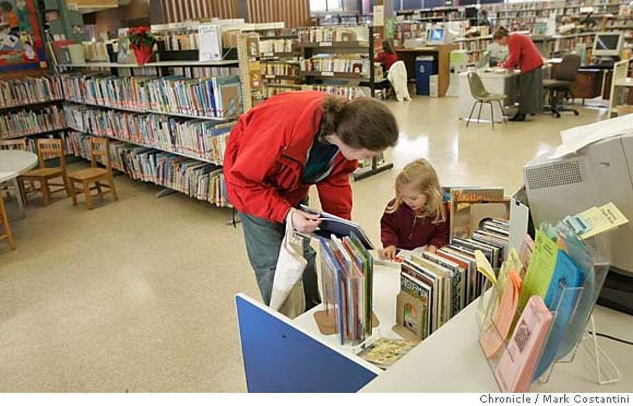 Rebecca Fisher and her daughter Alexandra Fisher, 2, Walnut Creek, look over children's books.  Walnut Creek wants a big new library to replace the aging one in its upscale downtown. Please get a photo/photos of the current Walnut Creek library Event on 12/12/05 in Walnut Creek.  Photo: Mark Costantini /San Francisco Chronicle. Photo: MARK COSTANTINI