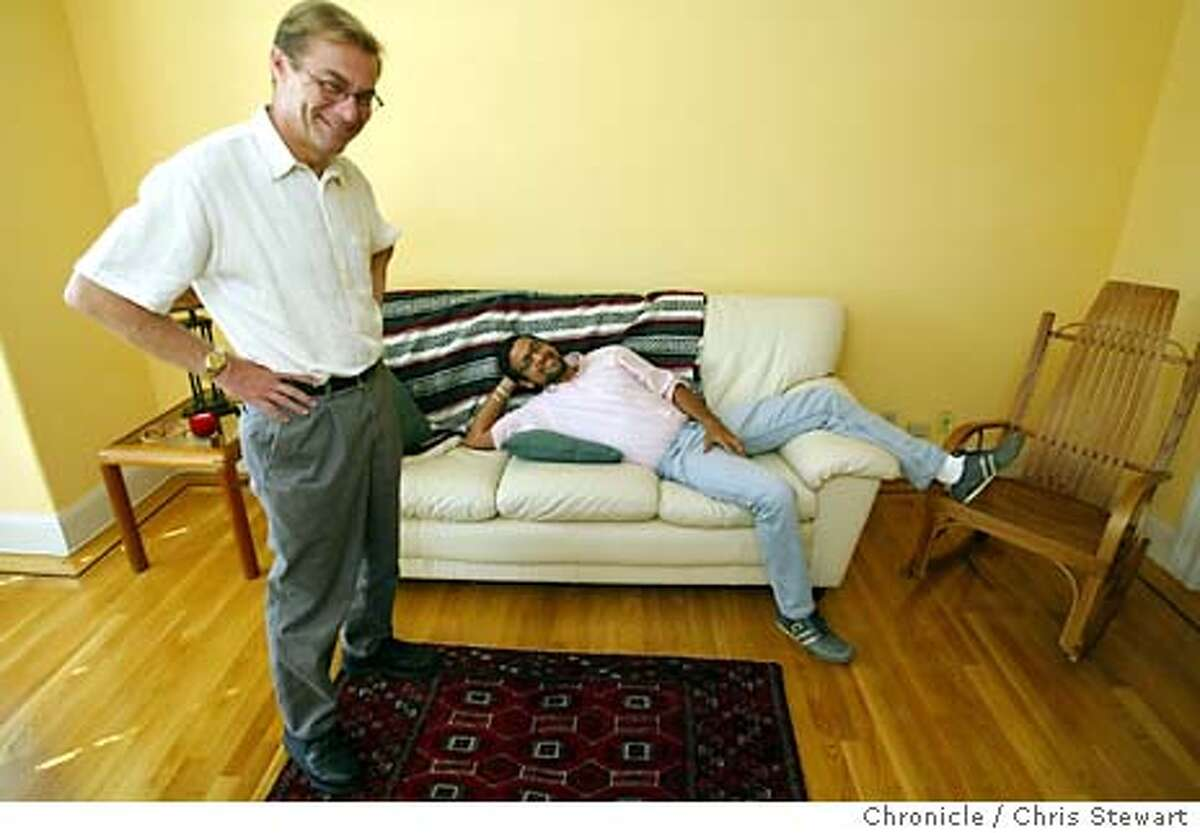 samesex036_cs.jpg Robert (L), 45, and Guillermo, 30, photographed in their SF home. The Bay Area has the highest