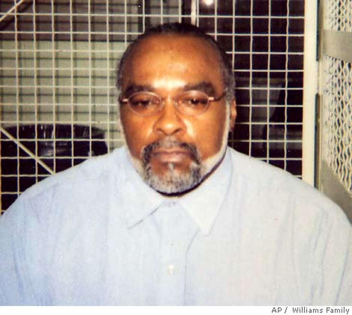 """** FILE ** In this undated photo provided by the family of Stanley Williams, Stanley """"Tookie"""" Williams poses for a photo in the visiting area of San Quentin State Prison in California. Prosecutors asked the California Supreme Court on Sunday, Dec. 11, 2005 to reject former gang leader and convicted killer Williams' request to block his execution, set for early Tuesday. (AP Photo/Courtesy of Williams Family, File) Ran on: 12-12-2005 Ran on: 12-12-2005"""