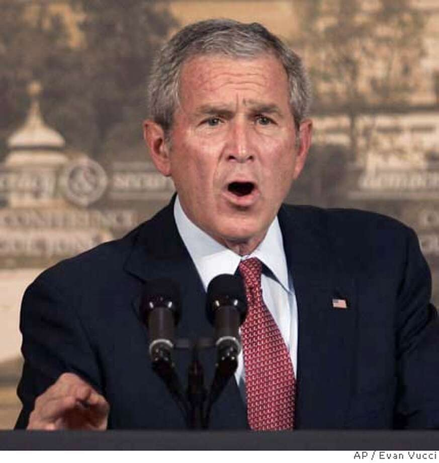 "U.S. President George W. Bush gestures during a speech at the Czernin Palace in Prague, on Tuesday, June 5, 2007. U.S. President George W. Bush risked further fueling tensions with Russia on Tuesday, saying Moscow had ""derailed"" once-promising democratic reforms. (AP Photo/Evan Vucci) Photo: Evan Vucci"