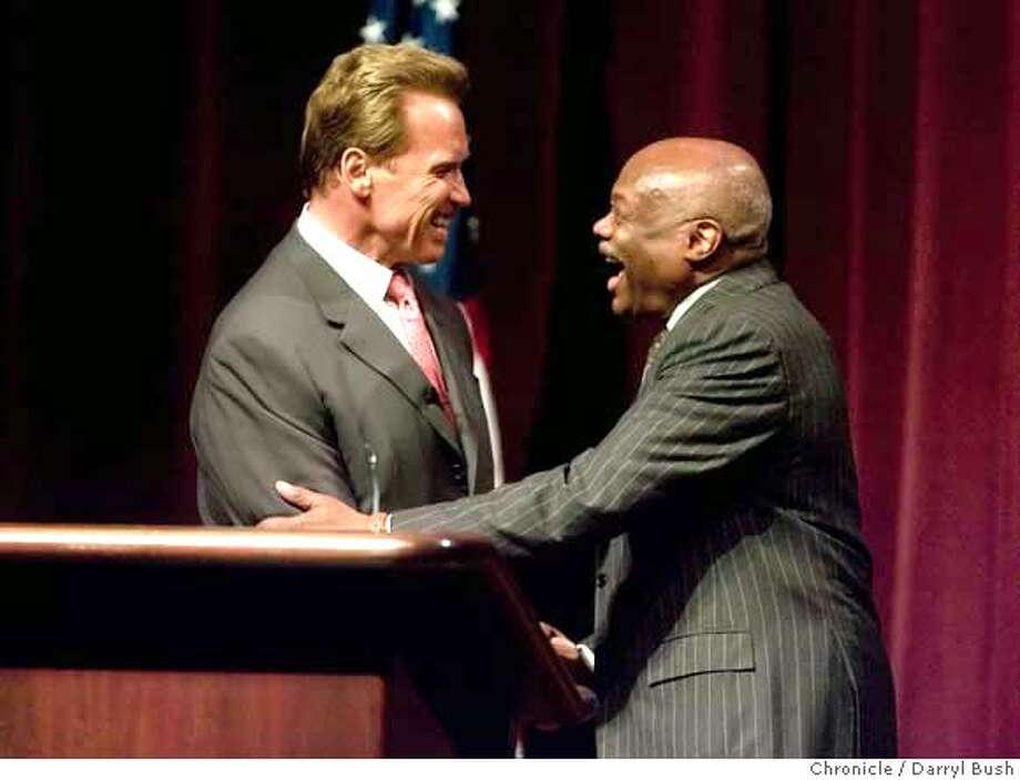 "governor_0001_db.JPG  Former San Francisco Mayor Willie Brown shakes hands with Governor Arnold Schwarzenegger after Brown introduced Schwarzenegger to an audience waiting to hear Schwarzenegger speak about California, regarding a program presented by San Francisco Chamber of Commerce called, ""A Vision for California,"" at downtown PG&E Company's auditorium in San Francisco, CA, on Tuesday, June, 5, 2007. photo taken: 6/5/07  Darryl Bush / The Chronicle ** (cq) MANDATORY CREDIT FOR PHOTOG AND SF CHRONICLE/NO SALES-MAGS OUT Photo: Darryl Bush"