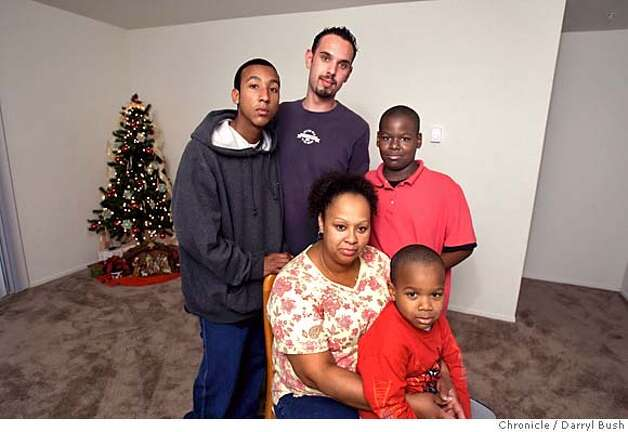 wallis09_0016_db.jpg  Rose Wallis mother with her four sons in her apartment, from left: Joseph Madina, 16, Josh Lopez, 25, Jamar Gray, 11, and Jordan Gray, 4.  Event on 12/8/05 in San Jose.  Darryl Bush / The Chronicle MANDATORY CREDIT FOR PHOTOG AND SF CHRONICLE/ -MAGS OUT Photo: Darryl Bush