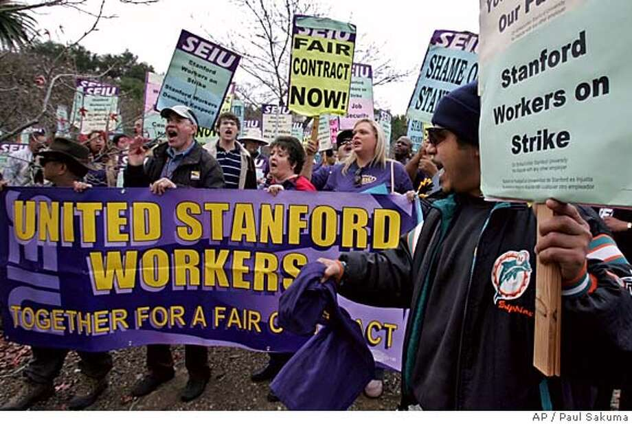 Striking Stanford University workers and their supporters shout during a rally outside administrative offices on the Stanford, Calif., campus, Monday, Dec. 12, 2005. Thousands of service workers walked off the job Monday over contract disputes related to wages and health care costs at the university and two medical facilities, union officials said. Officials with the Service Employees International Union said they expected several thousand workers to begin the one-day strike Monday morning. (AP Photo/Paul Sakuma) Photo: PAUL SAKUMA