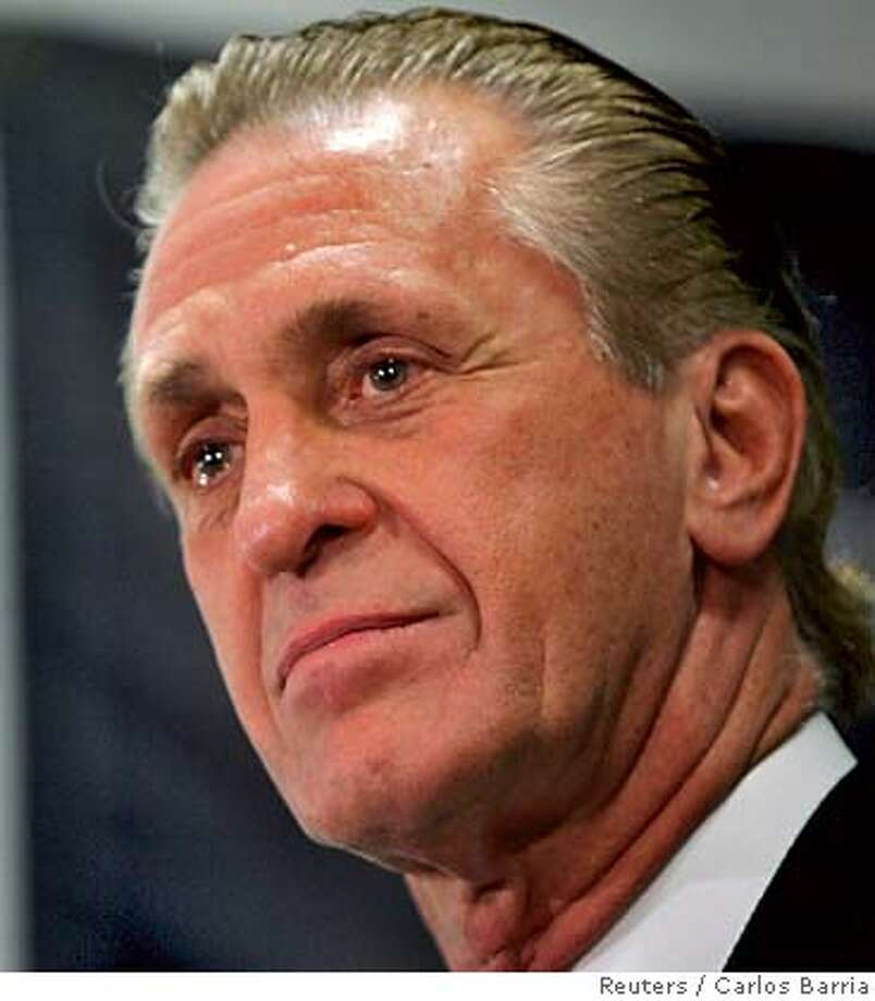 New Miami Heat coach Pat Riley talks during a news conference after Stan Van Gundy announced his resignation in Miami December 12, 2005. Van Gundy attributed his resignation to personal reasons. Miami has a record of 11-10 and resides atop the Southeast Division despite the absence of star center Shaquille O'Neal, who had missed 18 games with an ankle injury before returning Sunday in a 104-101 overtime victory against Washington. REUTERS/Carlos Barria 0 Photo: CARLOS BARRIA