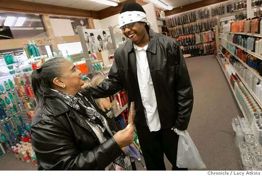 "K- Rob promotes himself when he introduces himself to Scyotria Penermon, 68 years old, from Richmond and gives her his lastest single on a CD at the New Ebony Beauty Supply Shop, Thursday Dec. 1, 2005, in Richmond. K-Rob and Flo; 2 p.m. meet on the front steps of Richmond Auditorium. K-Rob is the artist behind ""Rip the Club Up,"" and Flo his partner and record producer. Thursday Dec.1, 2005. Bill Harris; Harris and Jones Records, 3016 Cutting Bldv. Richmond  Richmond record store since 1968 is the sole place where the selling Bay Area single by K-Rob can be purchased. He has 25 years of memorabilia on the walls, photos of Little League teams he has sponsored and is oviously an instiution in the neighborhood.  v  Lacy Atkins / San Francisco Chronicle MANDATORY CREDIT FOR PHOTOG AND SF CHRONICLE/ -MAGS OUT Photo: LACY ATKINS"
