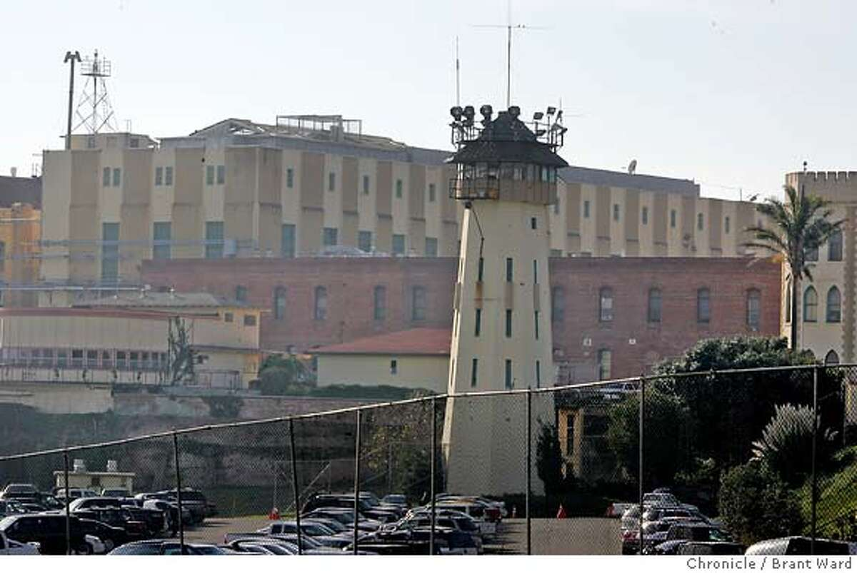 """San Quentin prison on Sunday...one of the death row areas is the top floor of the yellow building in back of guard tower. Only a few protesters showed up at the gates of San Quentin prison Sunday...as everyone awaited word whether Stanley """"Tookie"""" Williams would be granted clemency. Brant Ward12/11/05"""