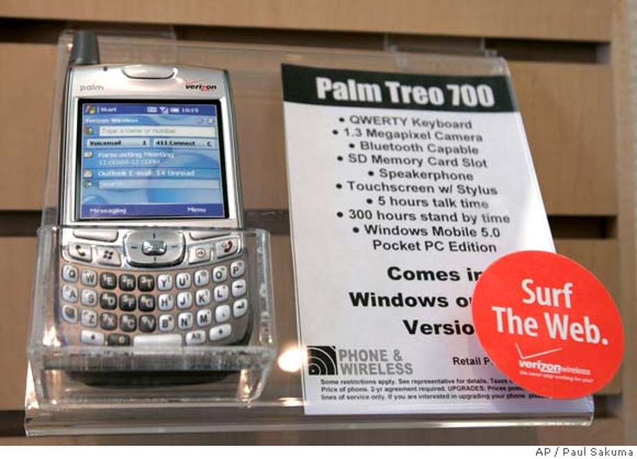 A Palm Treo 700 phone on display at a Verizon store in Salinas, Calif., Monday, June 4, 2007. Smartphone maker Palm Inc. will sell a 25 percent stake to private equity firm Elevation Partners for $325 million and name the former technical guru behind the iPod to be chairman, the company said Monday. The deal with the long-term investor brings significant new leadership to Palm, which has been battling stiffening competition in a market that is only going to get tougher with Apple Inc.'s June 29 debut of the iPhone. (AP Photo/Paul Sakuma) Photo: Paul Sakuma