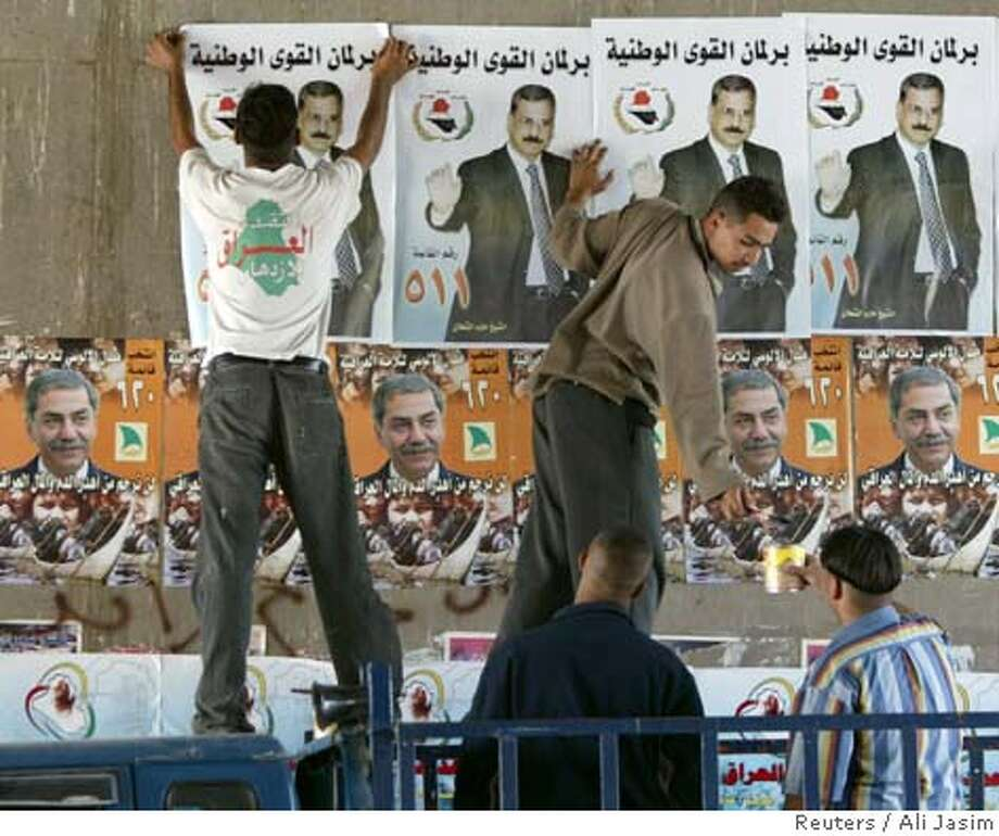 Iraqis hang election posters in central Baghdad, December 7, 2005. Iraqi officials and their American allies are pinning their hopes on December 15 elections for the first post-war, full-term government to defuse a Sunni Arab insurgency that has killed thousands of security forces and civilians. REUTERS/Ali Jasim Ran on: 12-11-2005  Election posters advertise Thursday's vote in Iraq, which has fueled Sunni Arab concern that a post-election pullout by U.S. troops could open the door to an all-out civil war. Photo: ALI JASIM