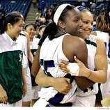 HEART_15010.JPG Sacred Heart #35 Jazmine Jackson and #44 Monique Calvello  hug after