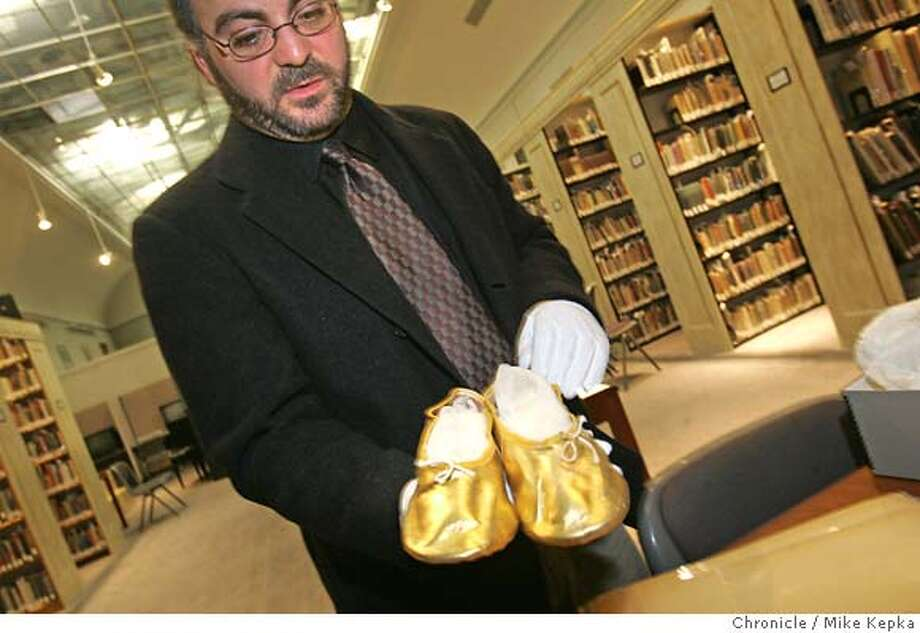 hurwitt12048seqn}_mk.JPG  Brad Rosenstein, curator of Exhibitions and Programs shows off a pair of golden dance slippers worn by dancer Lew Christensen in 1939. The San Francisco Performing Arts Library and Museum is looking for a new home for it rapidly growing archive of performing arts artifacts. San Francisco on date}. Mike Kepka / The Chronicle MANDATORY CREDIT FOR PHOTOG AND SF CHRONICLE/ -MAGS OUT Photo: Mike Kepka