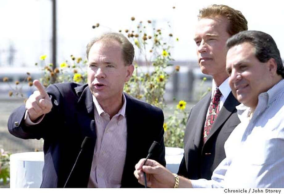 DSC_0094.JPG Schwarzenegger visits Coast Converters in Los Angeles. John Coupaul, President of the Howard Jarvis Taxpayers Assn. tells reporters about property taxes as and Chairman of the Board for Coast converters, Mitch Greif (striped shirt, no coat) listen.  . 9/12/03 in Los Angeles. JOHN STOREY / The Chronicle Photo: JOHN STOREY