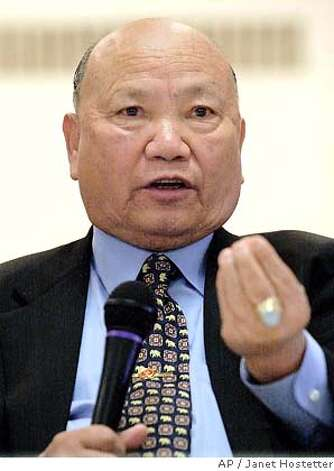 **FILE** Former military leader Gen. Vang Pao meets with the Twin Cities Hmong community in St. Paul, Minn., in this May 21, 2004 photo. A former Laotian general who helped the CIA wage covert war in Southeast Asia 30 years ago was charged Monday, June 4, 2007, with trying to overthrow Laos' communist government. General Vang Pao, a prominent Hmong leader who now lives in Westminster in Orange County, was charged with conspiracy to topple Laos' leaders in a case that officials said could affect relations between the two former foes. (AP Photo/Janet Hostetter, File) Photo: Janet Hostetter