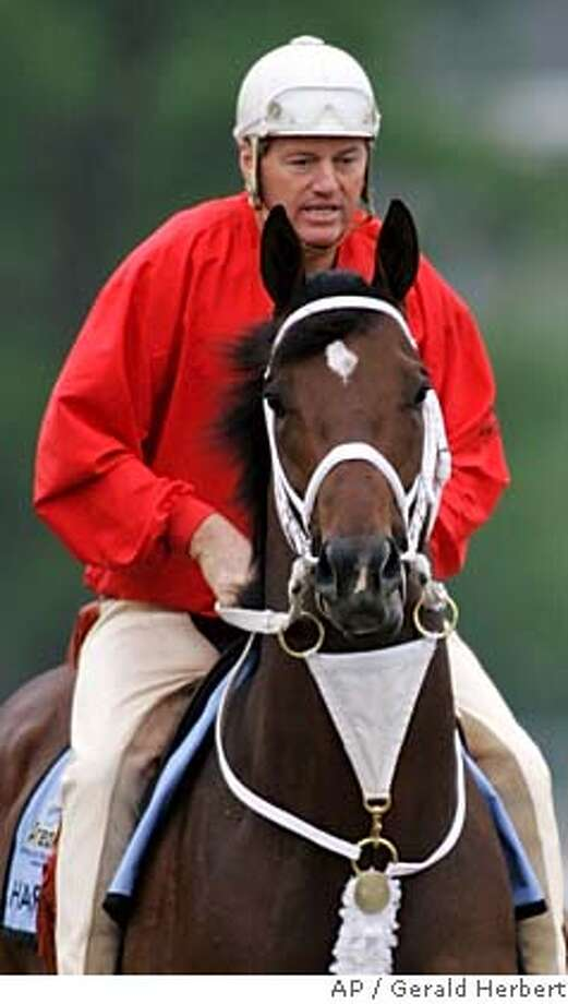 Trainer Larry Jones gives his Preakness Stakes entry, Hard Spun a morning workout on the track at Pimlico Race Course in Baltimore, Friday, May 18, 2007, one day before the running of the 132nd Preakness. (AP Photo/Gerald Herbert) EFE OUT Photo: Gerald Herbert