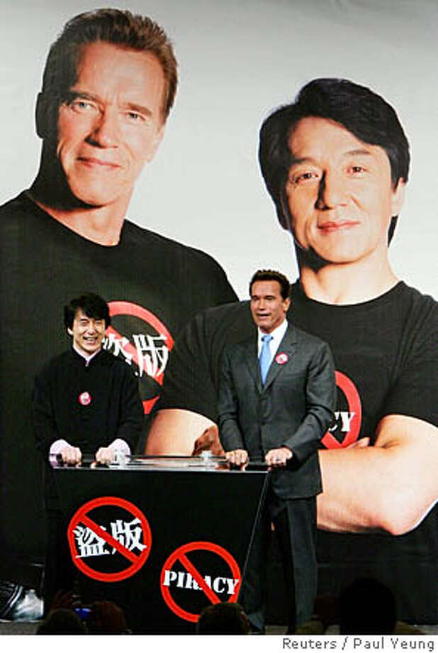 Governor of the State of California Arnold Schwarzenegger (R) and Hong Kong movie star Jackie Chan pose at a ceremony launching a new TV Announcement in the Public Interest (API) to fight piracy during a luncheon in Hong Kong November 18, 2005. Schwarzenegger is visiting China and Hong Kong until November 19, 2005 on behalf of California business to promote its goods and services, and highlight the importance of intellectual property rights enforcement. REUTERS/Paul Yeung Photo: PAUL YEUNG