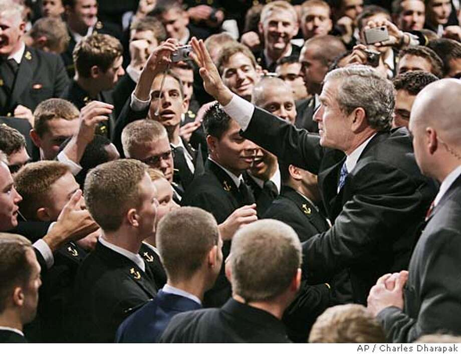 "U.S. President Bush shakes greets U.S. Naval Academy midshipmen after speaking about the war in Iraq at the U.S. Naval Academy in Annapolis, Md., Wednesday, Nov. 30, 2005. President Bush, facing growing doubts about his war strategy, said Wednesday that Iraqi troops are increasingly taking the lead in battle but that ""this will take time and patience."" He refused to set a timetable for withdrawing U.S. forces. (AP Photo/Charles Dharapak) Ran on: 12-11-2005  President Bush greets midshipmen at the U.S. Naval Academy in Annapolis, Md., after speaking about the Iraq war on Nov. 30. Photo: CHARLES DHARAPAK"