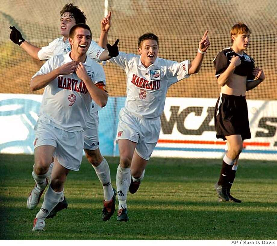 Maryland's Jason Garey (9), Robbie Rodger (8) and Marc Burch (15), back, run past New Mexico's Matt Wootton (17) to their teammates to celebrate their 1-0 win for the NCAA Division 1 Men's Soccer Championship at SAS Stadium in Cary, N.C. on Sunday, Dec. 11, 2005. (AP PHOTO/Sara D. Davis) Photo: SARA D. DAVIS