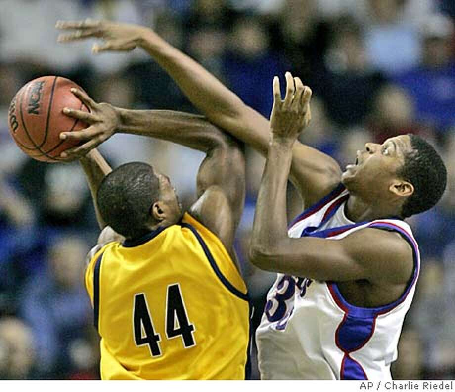 Kansas center C.J. Giles, right, blocks a shot by California forward Leon Powe (44) during the second half, Saturday, Dec. 10, 2005, at Kemper Arena in Kansas City, Mo. Giles scored 17 points leading Kansas to a 69-56 win. (AP Photo/Charlie Riedel) Photo: CHARLIE RIEDEL