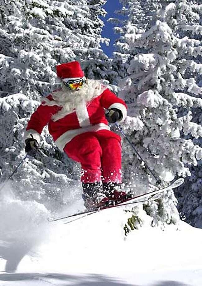 Santa on skis Photo: Larry Pierce