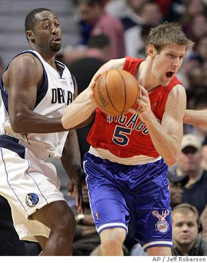 Chicago Bulls' Andres Nocioni of Argentina, right, lets out a yell as he looks to pass while Dallas Mavericks' Adrian Griffin, left, looks on during the second quarter Monday, Dec. 5, 2005 in Chicago. The Mavericks won the game, 102-94. (AP Photo/Jeff Roberson) Photo: JEFF ROBERSON