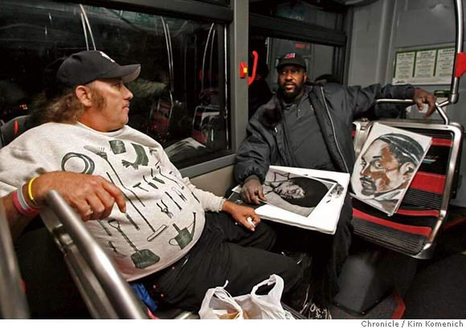 "NIGHTOWL_025_KK.JPG  Tom Bertke of Oakland Reginald Jones of Oakland (with Snoop Dog and Moichael Jackson drawings he drew) talk while riding AC Transit's all-night 800 line, the ""Nightowl."" The bus makes its way from Market and Van Ness to the Richmond BART station. The transit agency hopes to boost ridership among east bay working people and weekend nightclubbers.  Photo by Kim Komenich/The Chronicle  **Tom Bertke, REginald Jones �2007, San Francisco Chronicle/ Kim Komenich  MANDATORY CREDIT FOR PHOTOG AND SAN FRANCISCO CHRONICLE. NO SALES- MAGS OUT. Photo: Kim Komenich"