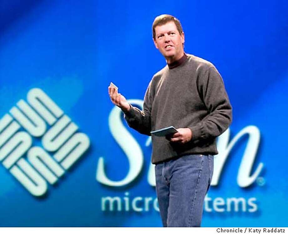 "Scott McNealy, the CEO of Sun Microsystems, makes a keynote speech at OracleWorld in San Francisco. He's showing his Belgian identity card, which uses Javascript, and is called in the computer biz a Java Card. McNealy is asking, ""Can I say we dominate? No, I probably shouldn't say that."" KATY RADDATZ / The Chronicle Photo: KATY RADDATZ"
