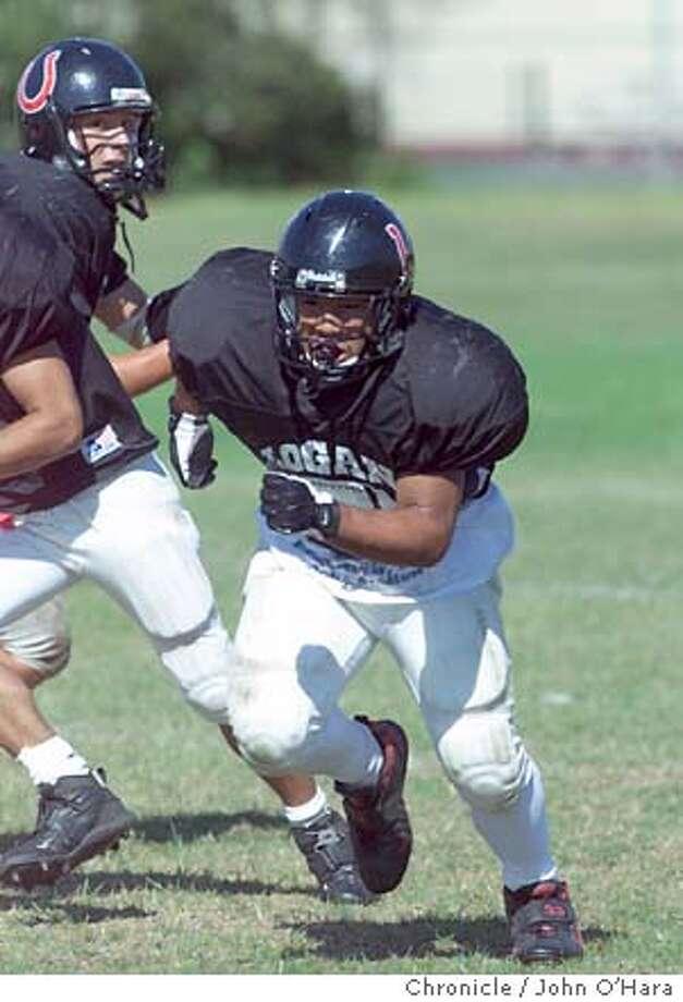 James Logan High School football players  Jonathan Ugay #33 coach Pete Queswinberry  football practice  photo/John O'Hara Photo: JOHN O'HARA