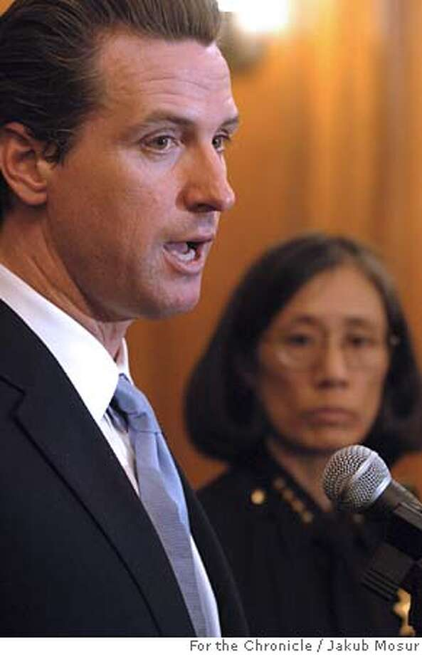 Mayor Gavin Newsom faces reporters with Chief of Police Heather Fong, right, Wednesday, Dec. 7, 2005, in San Francisco, where they announced that one police officer was suspended and more than a dozen others faced discipline after making videos parodying life on the force that used racist, sexist and homophobic stereotypes, according to Newsom and Fong. (AP Photo/The Chronicle, Jakub Mosur) ** MANDATORY CREDIT MAGS OUT ** MANDATORY CREDIT FOR PHOTOGRAPHER AND SAN FRANCISCO CHRONICLES -MAGS OUT Photo: JAKUB MOSUR