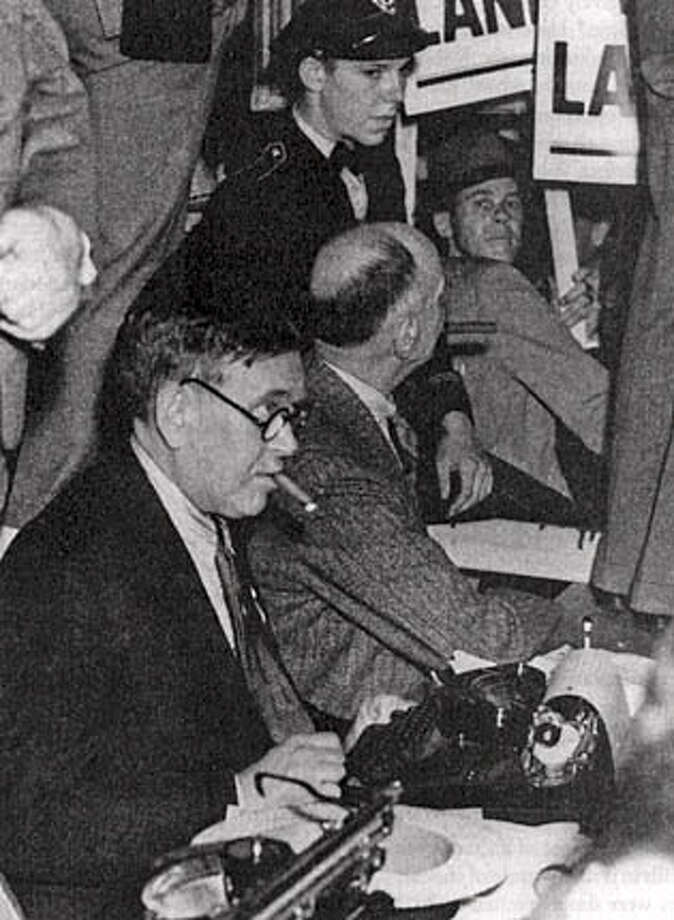 "H.L. Mencken at his typewriter, cigar firmly in place, covering the 1936 Republican convention. Photo from ""Mencken''"