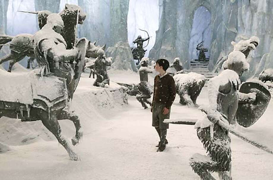 "Skandar Keynes (center) in ""The Chronicles of Narnia: The Lion, the Witch and the Wardrobe"" (2005) Buena Vista. Photo Credit: Phil Bray. Photo: Phil Bray"