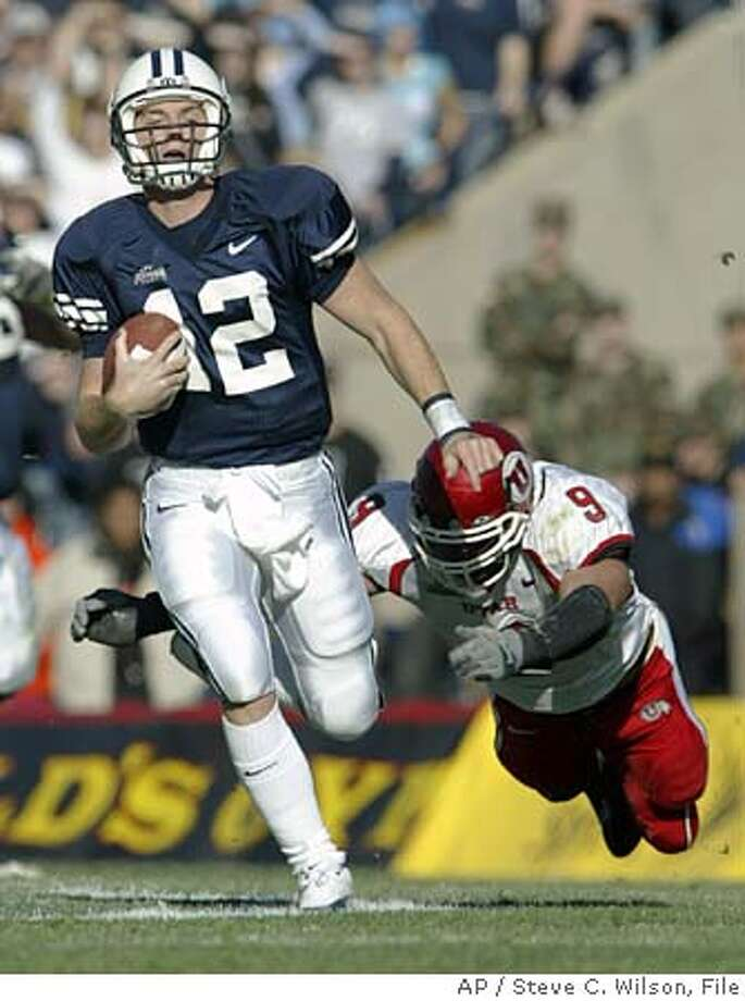 ** CORRECTS DATELINE TO PROVO INSTEAD OF SALT LAKE CITY ** Utah linebacker Spencer Toone, right, dives to bring down Brigham Young quarterback John Beck during the first half Saturday, Nov. 19, 2005, in Provo, Utah. (AP Photo/Steve C. Wilson) CORRECTS DATELINE TO PROVO INSTEAD OF SALT LAKE CITY Photo: STEVE C WILSON