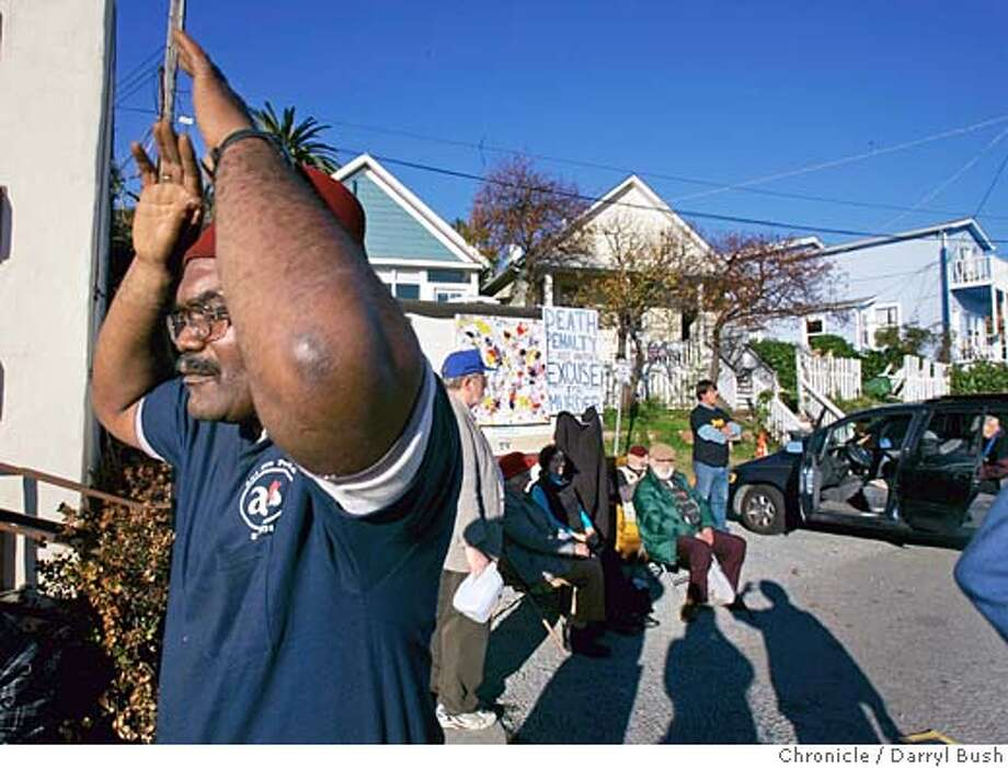 "Elohim Bey of Richmond, meditates while waiting with fellow supporters for ""Tookie Williams"" opposing the death penalty wait outside San Quentin State Prison for any word from the Governor's office.  Event on 12/10/05 in San Quentin.  Darryl Bush / The Chronicle Photo: Darryl Bush"