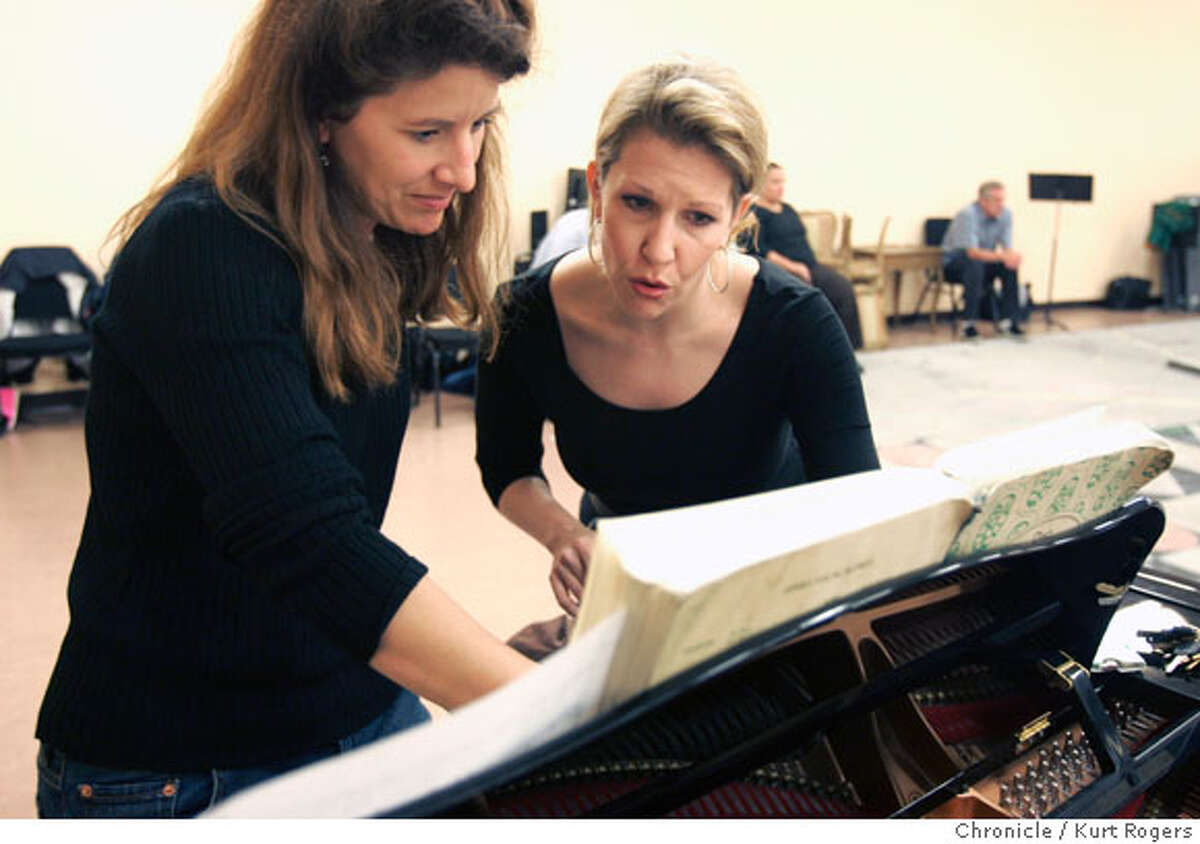 L2R Pianist Adelle Eslinger (cq) and Joyce DiDonato (cq) look over the music douing a brake in the rehearsal. Joyce DiDonato who will be appearing it he SF Opera's performance of Strauss