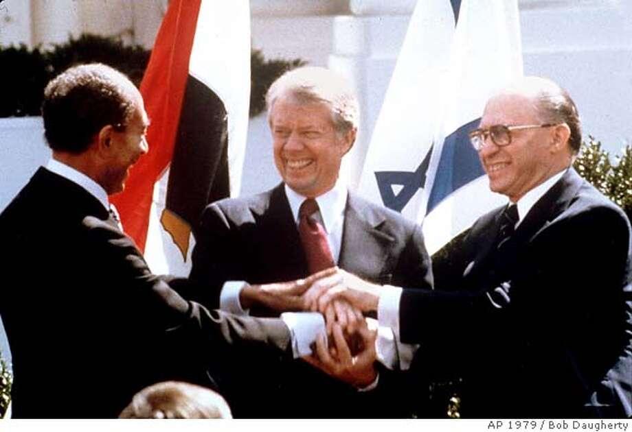 Egyptian President Anwar Sadat, President Jimmy Carter, Israeli Prime Minister Menachem Begin at the White House. Associated Press photo, 1979, by Bob Daugherty