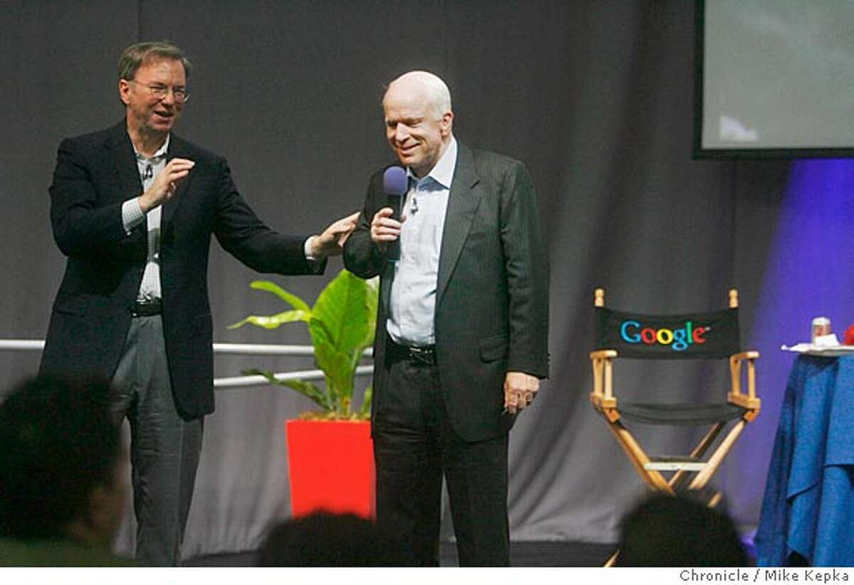 mccain_google000007_mk.JPG Hosted Eric Schmidt, CEO of Google, Republican Presidential candidate John McCain visits Google for a Town Meeting with Google employees. Mike Kepka / The Chronicle Eric Schmidt John McCain (cq) Ran on: 06-04-2007 Google employees (from left) Maureen Feeny, Cristine Wu and Koon Chow are in the audience for candidate John Edwards at Googles Mountain View campus.