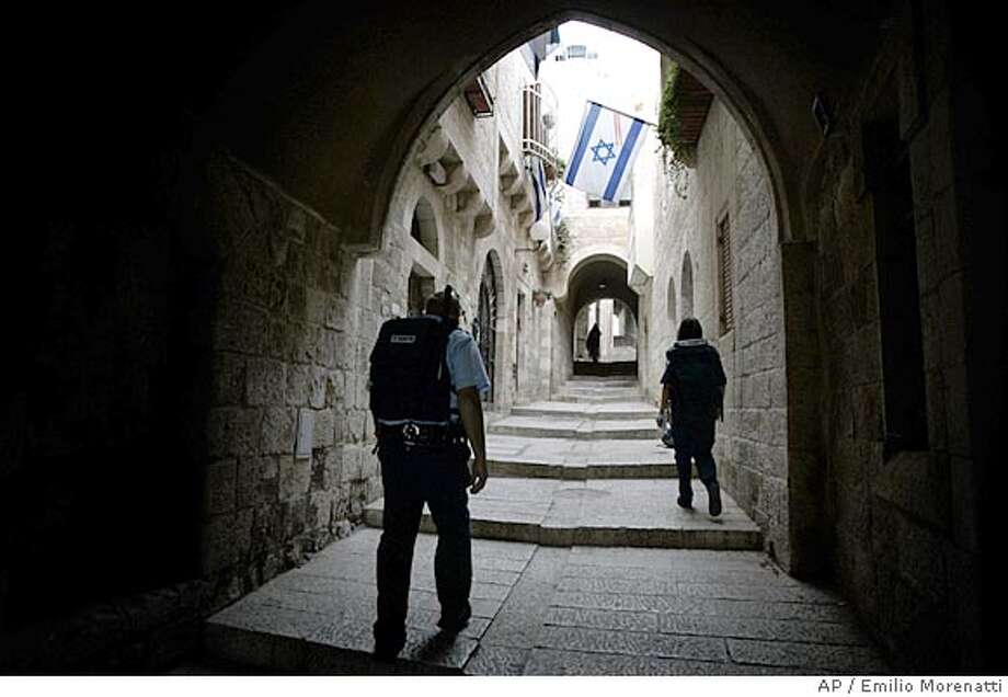 ** ADVANCE FOR SUNDAY, JUNE 3 ** Israeli police officer patrols the Jewish Quarter in Jerusalem's Old City, May 1, 2007. Four decades after an underdog Israeli military campaign that captured the world's imagination, the people of Israel, the Middle East and the world are are still struggling to come to terms with it. The war tripled Israel's size and probably prevented its annihilation. But with victory came burdens, hatreds and many, many deaths for Israelis and the Palestinians in their newly-expanded territory.(AP Photo/Emilio Morenatti) Photo: EMILIO MORENATTI