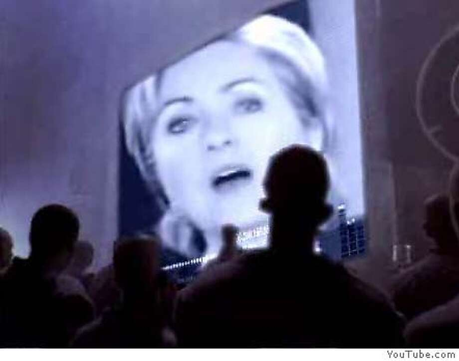 """� Frame grab from YouTube.com showing the """"Hillary 1984"""" video, which transforms an old Apple TV commercial into an ad touting Barack Obama's presidential campaign. COURTESY YOUTUBE Ran on: 03-20-2007 Images from YouTube.com show the &quo;Hillary 1984&quo; video, which transforms an old Apple TV commercial introducing the Macintosh computer during the 1984 Super Bowl into an ad touting Barack Obama's campaign. Ran on: 03-20-2007 Images from YouTube.com show the &quo;Hillary 1984&quo; video, which transforms an old Apple TV commercial introducing the Macintosh computer during the 1984 Super Bowl into an ad touting Barack Obama's campaign. ALSO Ran on: 03-22-2007 Sen. Hillary Rodham Clinton appears in the video on YouTube.com that remade an old Apple commercial into an ad touting Barack Obama's campaign. Ran on: 03-22-2007 Sen. Hillary Rodham Clinton appears in the video on YouTube.com that remade an old Apple commercial into an ad touting Barack Obama's campaign. Photo: YOUTUBE"""