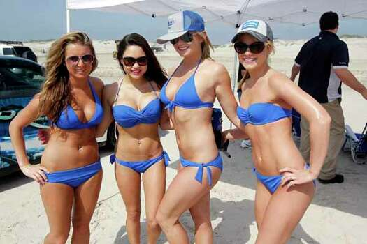 The Bud Light girls pose for a photo Wednesday, March 14, 2012 during spring break at J.P. Luby Park in Corpus Christi, Texas. (AP Photo/Corpus Christi Caller-Times, Michael Zamora) Photo: Michael Zamora, Associated Press / Corpus Christi Caller-Times
