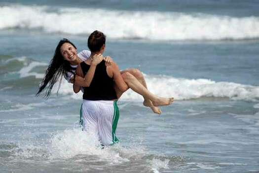 Ebony Charles, 15, of Alice, Texas, laughs as her sister, Demi Mendoza, 13, drags her out into the water Wednesday, March 14, 2012 as they spend spring break at J.P. Luby Park in Corpus Christi, Texas. (AP Photo/Corpus Christi Caller-Times, Michael Zamora) MANDATORY CREDIT; MAGS OUT; TV OUT Photo: Michael Zamora, Associated Press / AP2012