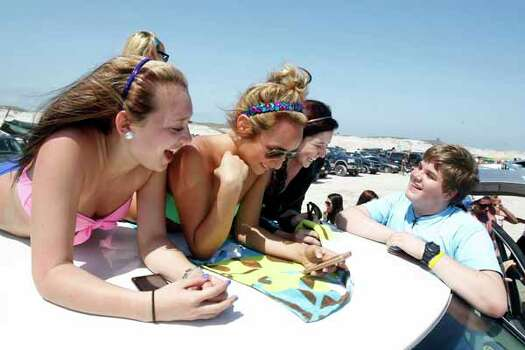 King High School students Amber Sanchez, 16 (from left), Candis Longoria, 17, Kristen Chapa, 16, and Lee Faldet, 16, hang out on top of their truck Wednesday, March 14, 2012 as they spend spring break at J.P. Luby Park in Corpus Christi, Texas. (AP Photo/Corpus Christi Caller-Times, Michael Zamora) MANDATORY CREDIT; MAGS OUT; TV OUT Photo: Michael Zamora, Associated Press / AP2012