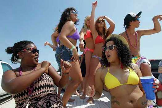 Senior Oshean Green, left, and junior Liberty Franklin dance with their classmates from Carroll High School Friday, March 16, 2012 during spring break near Padre Island in Corpus Christi, Texas. (AP Photo/Corpus Christi Caller-Times, Michael Zamora) MANDATORY CREDIT; MAGS OUT; TV OUT Photo: Michael Zamora, Associated Press / AP2012