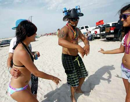 Joel Ruiz of Alice, Texas, dances while drinking from his cowboy beer hat Friday, March 16, 2012 during spring break near Padre Island in Corpus Christi, Texas. (AP Photo/Corpus Christi Caller-Times, Michael Zamora) MANDATORY CREDIT; MAGS OUT; TV OUT Photo: Michael Zamora, Associated Press / AP2012