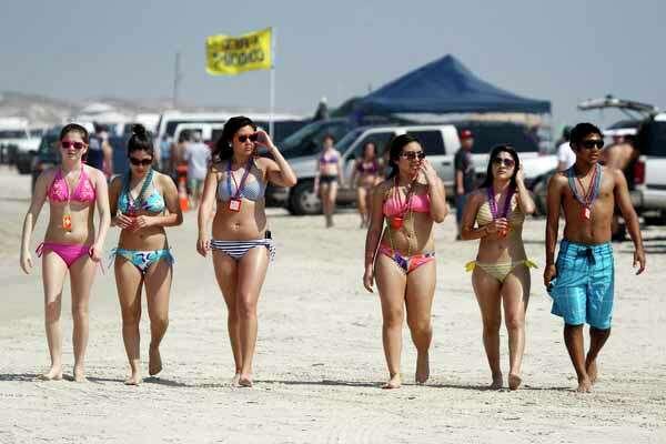 Spring breakers hit the beach Wednesday, March 14, 2012 at J.P. Luby Park in Corpus Christi, Texas. (AP Photo/Corpus Christi Caller-Times, Michael Zamora)