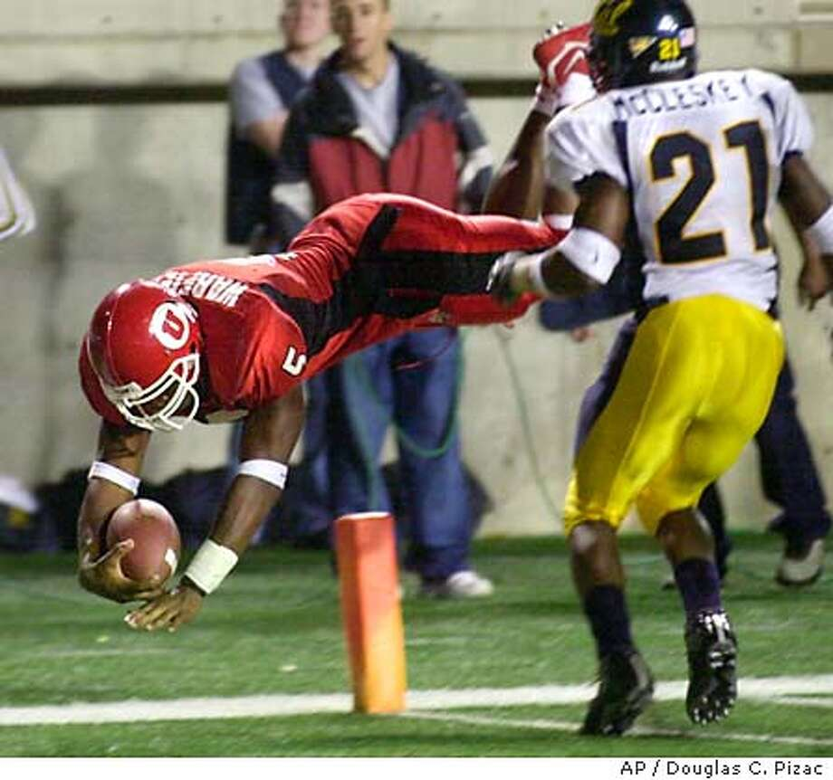 Utah runningback Brandon Warfield (5) leaps over the goal line to score the winning touchdown against California defensive back Donnie McCleskey during the fourth quarter Thursday, Sept. 11, 2003, in Salt Lake City. Utah beat Cal 31-24. (AP Photo/Douglas C. Pizac) Photo: DOUGLAS C. PIZAC