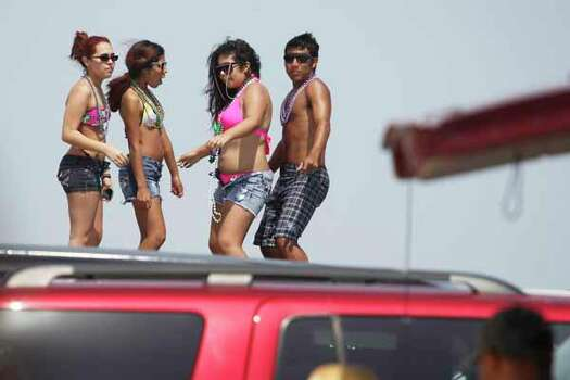 Spring breakers dance on top of vehicles Friday, March 16, 2012 during spring break near Padre Island in Corpus Christi, Texas. (AP Photo/Corpus Christi Caller-Times, Michael Zamora) MANDATORY CREDIT; MAGS OUT; TV OUT Photo: Michael Zamora, Associated Press / AP2012