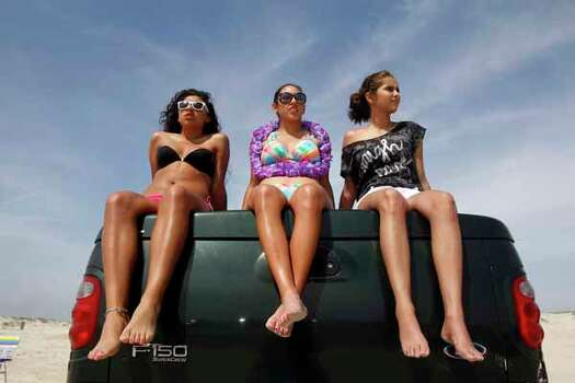 Mariah Silvas, 18, left, Kelsey Canales, 16, center, and Megan Garcia, 17, all students at Moody High School, watch the crowds start to gather Thursday March 15, 2012 on the beach in Corpus Christi, Texas. (AP Photo/Corpus Christi Caller-Times, Michael Zamora) TV OUT, MAGS OUT; MANDATORY CREDIT Photo: Michael Zamora, Associated Press / AP2012