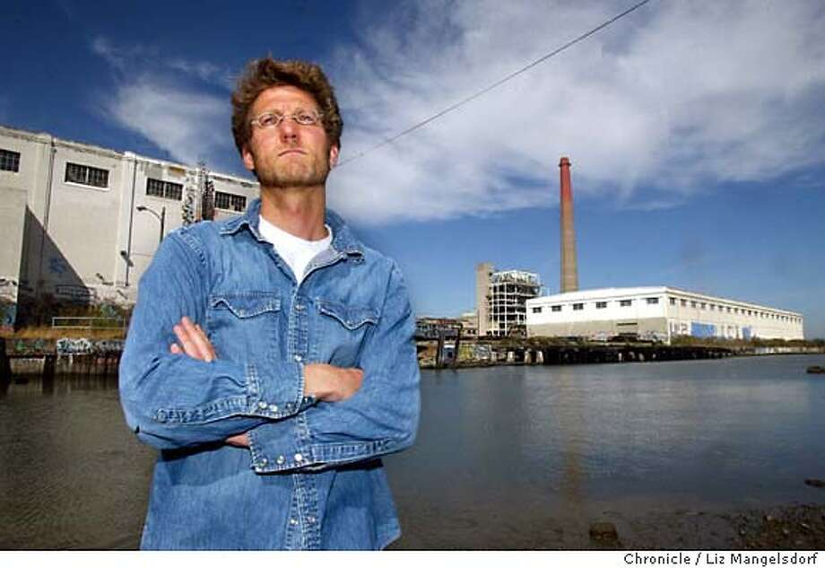 46FB0010.JPG Event on 9/10/03 in San Francisco. John Borg, a resident and business man in dogpatch, who has been leading the neighborhood opposition. This is a picture at Islais Creek(, which runs near the power plant (with the smoke stack...not the white building) in the background.  LIZ MANGELSDORF / The Chronicle Photo: LIZ MANGELSDORF