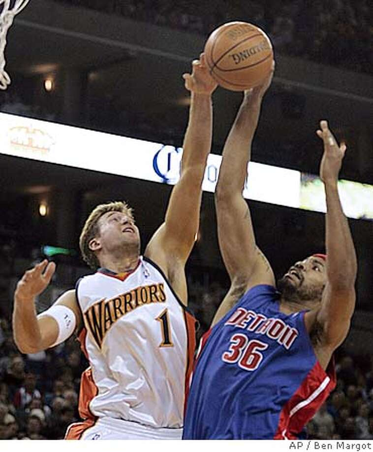 Golden State Warriors' Troy Murphy, left, blocks a shot by Detroit Pistons' Rasheed Wallace in the first half Friday, Dec. 9, 2005, in Oakland, Calif. (AP Photo/Ben Margot) Ran on: 12-10-2005  Warriors forward Troy Murphy blocks a shot by Detroit's Rasheed Wallace, who nevertheless had 24 points. Photo: BEN MARGOT